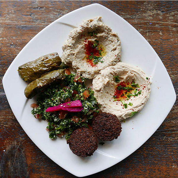 Hummus with falafel and stuffed grape leaves