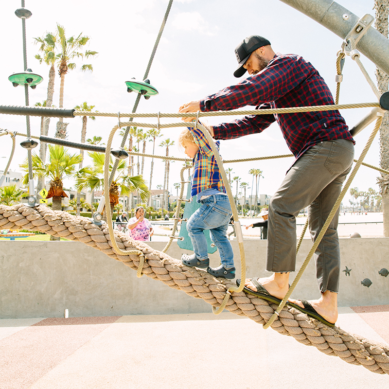 Adult and child playing at Ocean View Park in Santa Monica