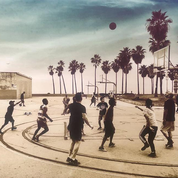 Photo of men playing basketball - Jeanie Madsen