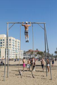 Man exercising at Original Muscle Beach in Santa Monica