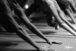 Women practicing yoga at Sweat Yoga