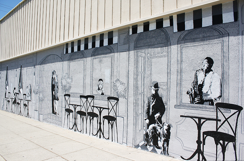 Mural of storefront and cafe