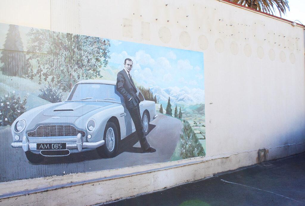 Mural of James Bond with Aston Martin car