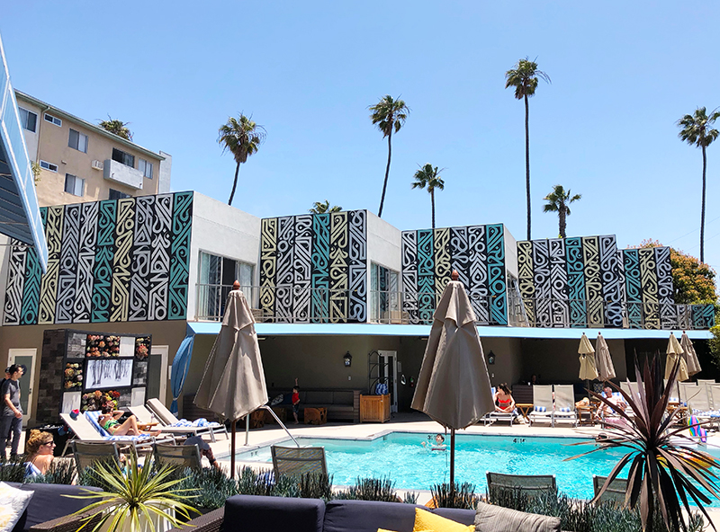 Patterned mural above pool