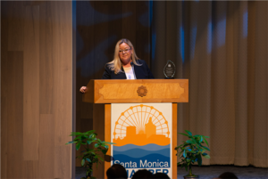 Misti Kerns, President and CEO of SMTT, accepts the Economic Excellence Award on behalf of Santa Monica's tourism industry.