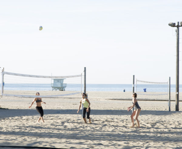 Group of women playing volleyball on Santa Monica Beach