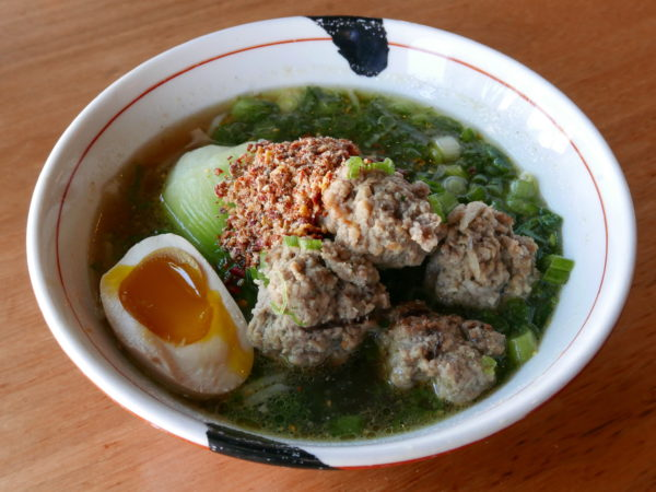 Spicy ramen with chicken broth, crumbly beef meatballs, bok choy, scallions and a seasoned egg from JINYA Ramen Bar