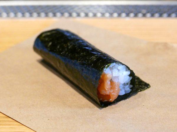 Salmon hand roll with warm rice in a crispy nori wrapper from KazuNori