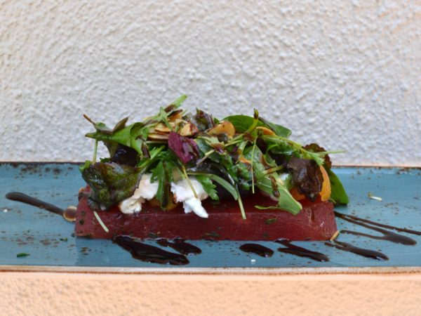 Roasted baby beets and burrata salad served on a slab of compressed watermelon from Le Troquet Patio Lounge