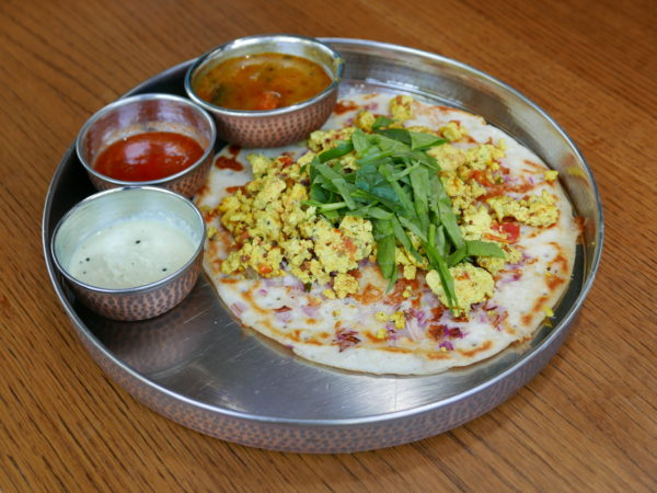 Uttapam: thick rice & lentil flour crepe topped with scrambled egg bhurji seasoned with onion-tomato-chile and curry leaf, served with sambar (south Indian soup), coconut and tomato chutneys from Tumbi Craft Kitchen