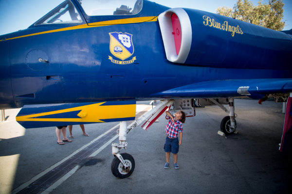 Child inspecting a plane at the Museum of Flying