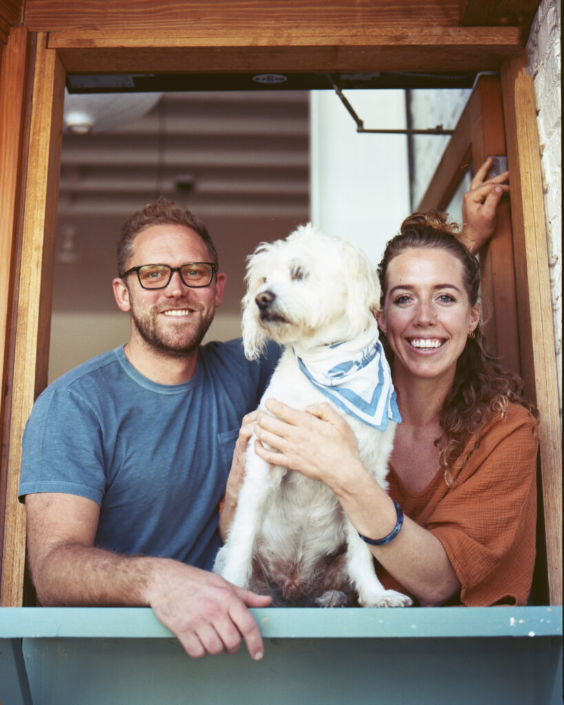 Brian Bornemann and Leena Culhane with a dog at Crudo e Nudo in Santa Monica
